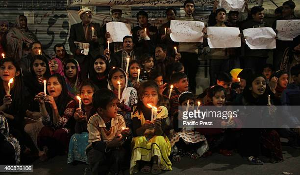 Pakistani students of Study in School gather in a candlelight vigil for the massacre of the innocent school children at Peshawar school