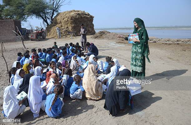 Pakistani students seen studying in a suburb of Lahore as people celebrates International Students on the eve of International Student Day in Lahore...
