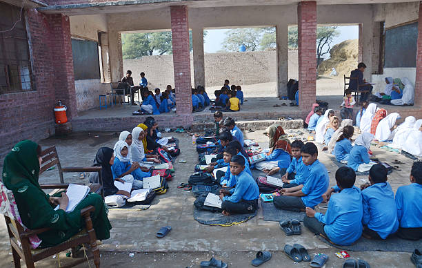 Pakistani students seen studying in a suburb of Lahore as people celebrates International Students on the eve of International Student Day in Lahore..
