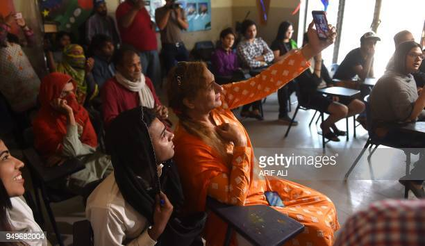 Pakistani students take a selfie in a class on the first day of the first transgender school in Lahore on April 21 2018 The school 'The Gender...