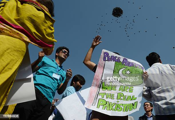Pakistani students take part of a protest against an antiIslam film after the Friday prayers in front of the Faisal Mosque in Islamabad on September...
