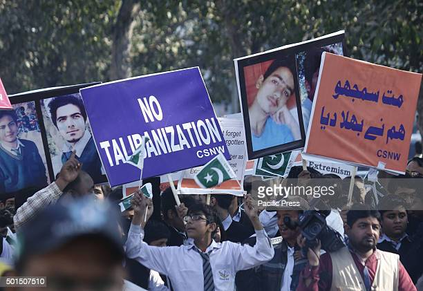 Pakistani studentsteachers and civil society activists carry placards as they march during a rally to pay tribute to the victims of the Peshawar...