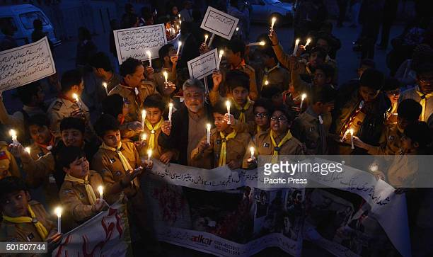 Pakistani studentsteachers and civil society activists hold lit candles during a vigil to pay tribute to the victims of the Peshawar school massacre...