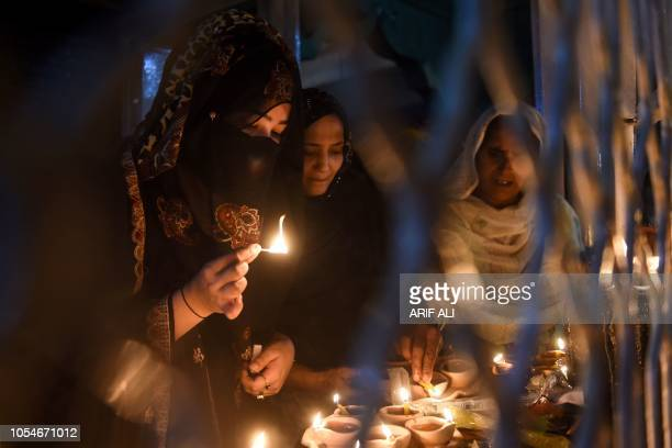 Pakistani Sufi disciples light lamps at the Data Darbar complex during the threeday annual 'Urs' religious festival in Lahore on October 28 2018 The...