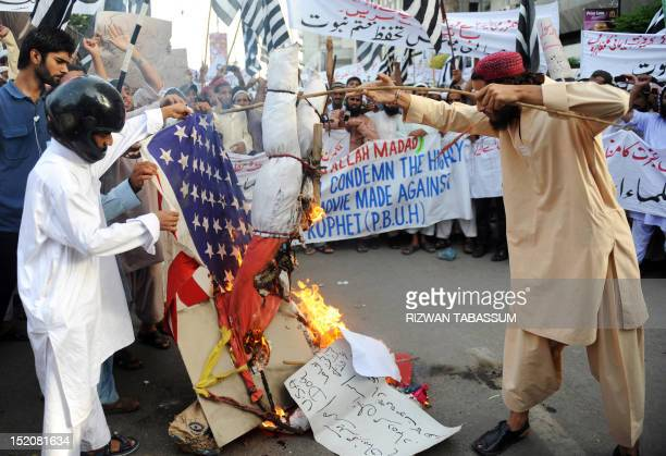 Pakistani Sunni Muslim protesters torch a US flag and an effigy of the US President Barack Obama during a protest rally against an antiIslam movie in...