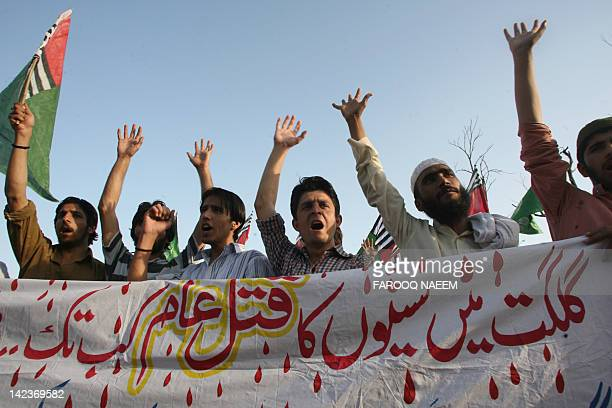 Pakistani Sunni Muslim students shout slogans during a demonstration for Gilgit shooting victims in Islamabad on April 3, 2012. Two people were...