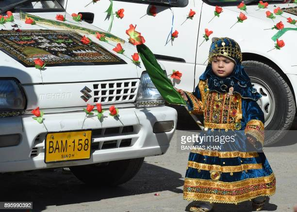 A Pakistani Sunni Muslim young girl takes part in a rally during celebrations marking EideMiladunNabi the birthday of Prophet Mohammad in Quetta on...