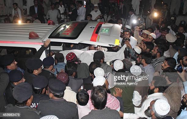 Pakistani Sunni Muslims carry the dead body of Sunni Muslim Leader ShamsurRehman Muawiya chief of the Ahle Sunaat Wal Jamaat organisation for Punjab...