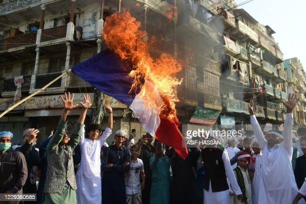 Pakistani Sunni Muslimsburn a French flag during a protest in Karachi on October 30 following French President Emmanuel Macron's comments over the...