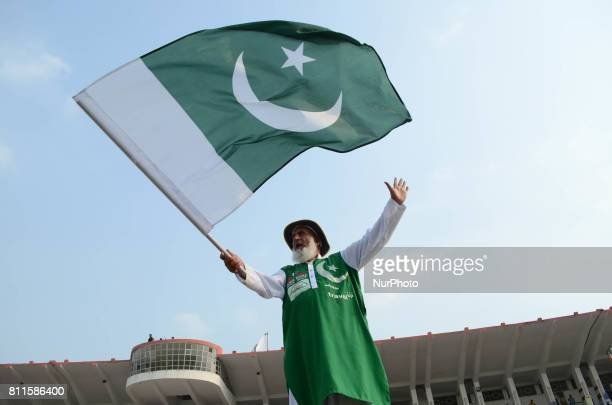 A pakistani supporter hold the flag during friendly matchJuly 9 2017 in Lahore Eight of football's biggest stars including Brazilian hero Ronaldinho...