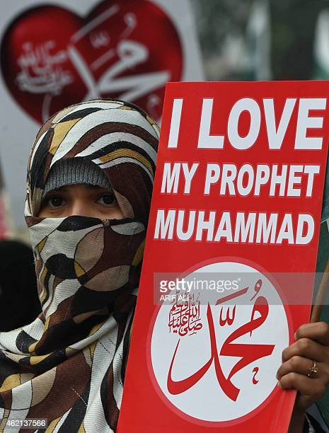 A Pakistani supporter of political and Islamic party JammateIslami holds a placard that reads Muhammad as they gather during a protest against the...