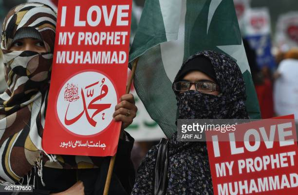 Pakistani supporter of political and Islamic party JammateIslami hold placards that read 'Muhammad' as they gather during a protest against the...