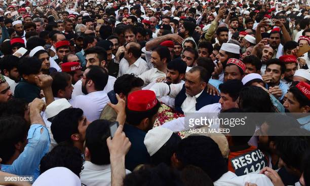 Pakistani supporters of Awami National Party carry the coffin of a local leader and candidate of ANP Haroon Bilour during his funeral in Peshawar on...