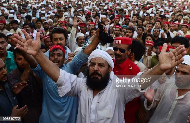 Pakistani supporters of Awami National Party shout slogans as they attend a funeral ceremony of a local leader and candidate of ANP Haroon Bilour in...