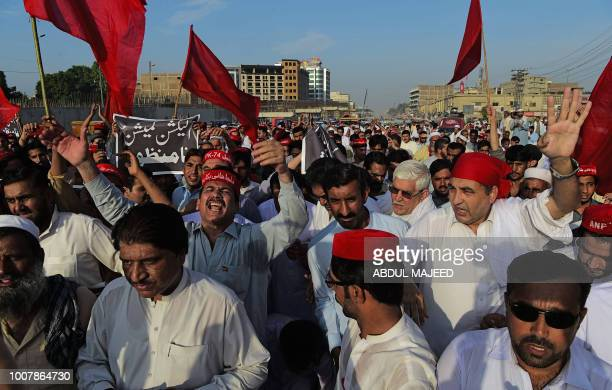 Pakistani supporters of Awami National Party shout slogans as they march during a protest against alleged election rigging in Peshawar on July 30...