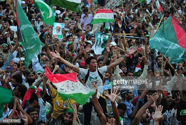 Pakistani supporters of Canadabased preacher TahirulQadri gesture and cheer as party songs play during an antigovernment march in Islamabad on August...