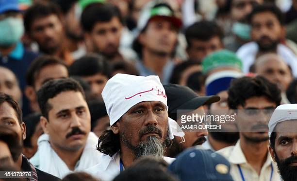 Pakistani supporters of Canadabased preacher TahirulQadri listen to Qadri speak during an antigovernment protest in front of the Parliament in...