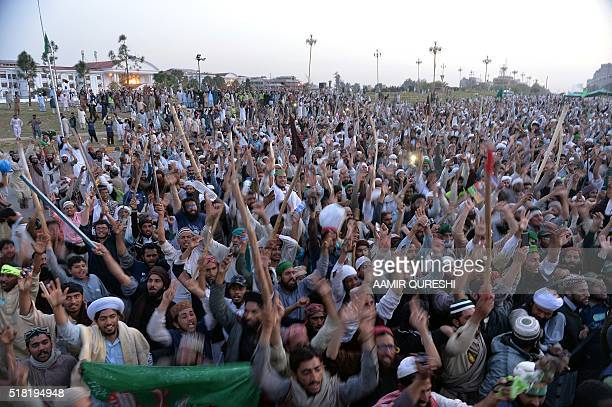 Pakistani supporters of convicted murderer Mumtaz Qadri celebrate after their leaders announced the end of a protest held in front of the parliament...