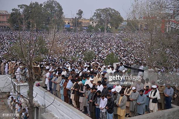 Pakistani supporters of convicted murderer Mumtaz Qadri offers funeral prayers for Qadri a day after his execution in Rawalpindi on March 1 2016 Tens...