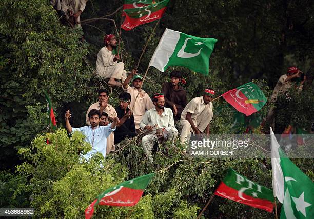 Pakistani supporters of cricketerturnedpolitician Imran Khan gather during protest rally against the country's Pakistan Muslim LeagueNawazled...