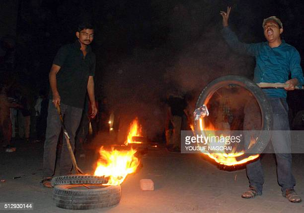 Pakistani supporters of former police bodyguard Mumtaz Qadri shout slogans as they torch tyres during a protest against the execution of Qadri in...