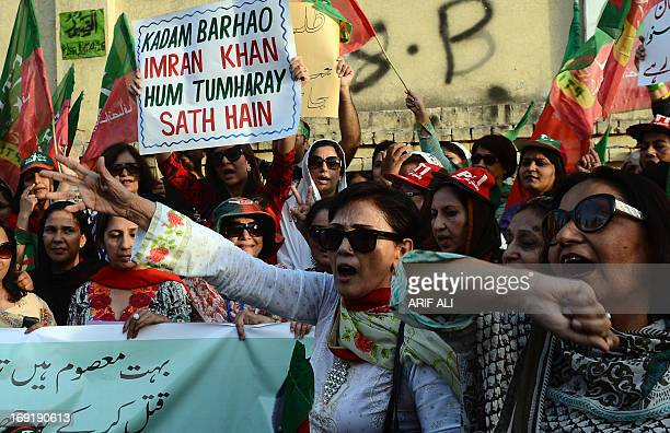 Pakistani supporters of Imran Khan, the head of Pakistan Tehreek-e-Insaf party take part in a protest against alleged vote rigging in Pakistan's...