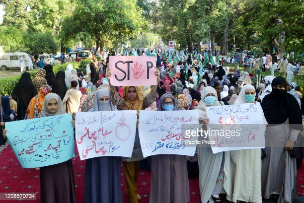 Pakistani supporters of Islamic political party Jamaat-e-Islami march during protest against an alleged gang rape of a woman in front of her three...