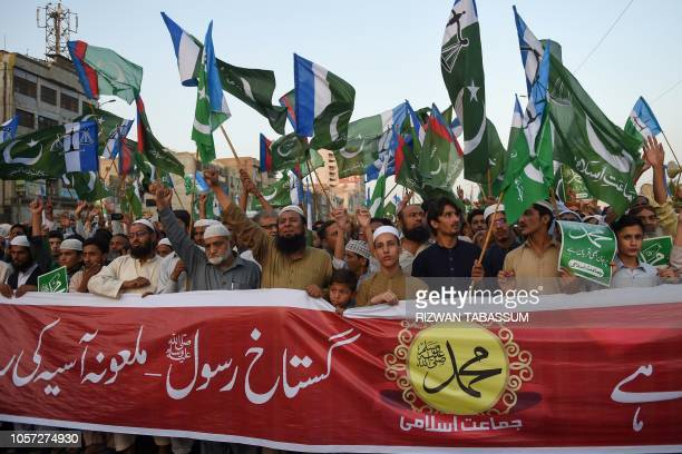 Pakistani supporters of JamaateIslami a religious political party chant slogans and gestures while waving the party falg during a protest following...