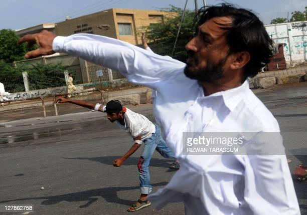 Pakistani supporters of Malik Mumtaz Hussain Qadri throw stones towards the police during a protest in Karachi on October 2, 2011. A Pakistani court...