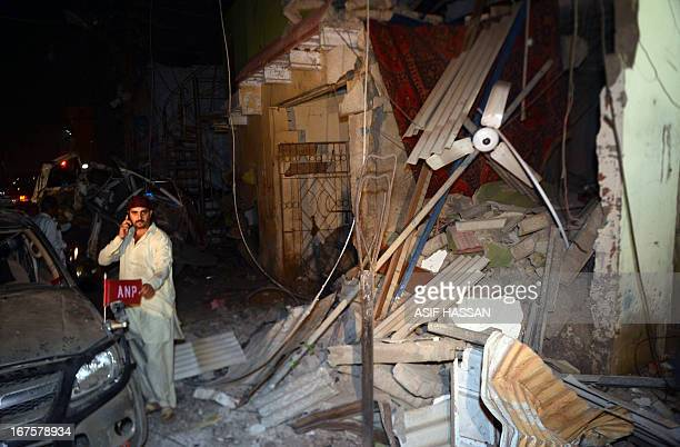 Pakistani supporters of Pashtundominated Awami National Party gather at the site of a bomb explosion in Karachi on April 26 2013 A car bomb exploded...