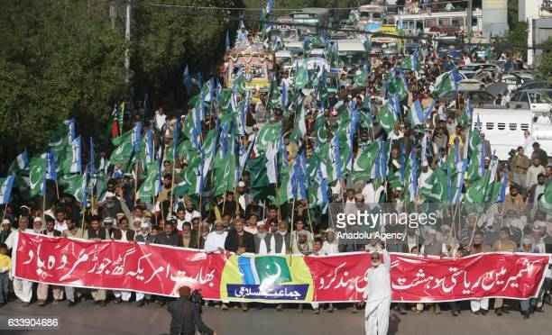 Pakistani supporters of Political and Islamic Party JammateIslami march during a demonstration to commemorate Kashmir Solidarity Day an...