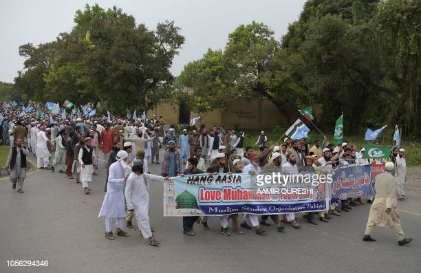 Pakistani supporters of the Ahle Sunnat Wal Jamaat a hardline religious party march during a protest rally following the Supreme Court's decision to...