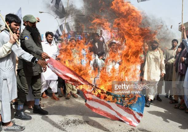 Pakistani supporters of the banned organisation JamaatudDawa burn a US flag in a protest in Quetta on May 27 against the US drone strike on Pakistani...