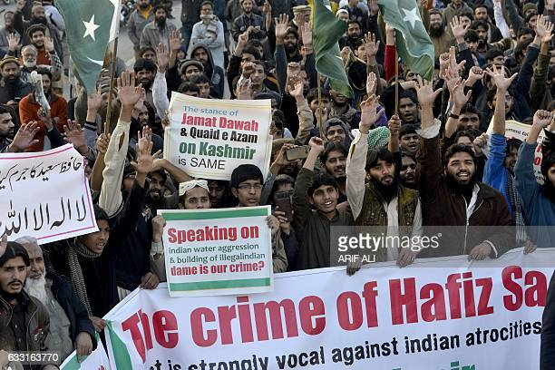 Pakistani supporters of the JamaatudDawa organisation shout slogans during a protest after JuD leader Hafiz Saeed was placed under house arrest by...