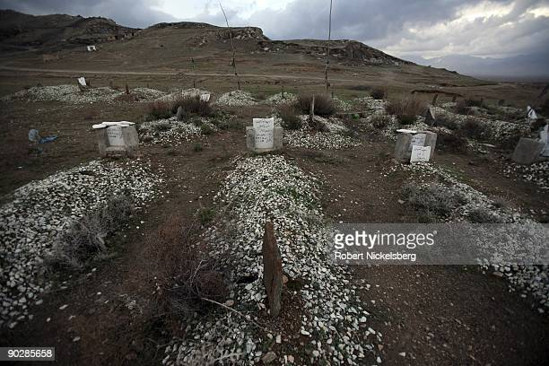 Pakistani taliban fighters from HarikatulAnsar lie in graves on April 2 2009 in Deh Sabs village north of Kabul Afghanistan Most of the several...