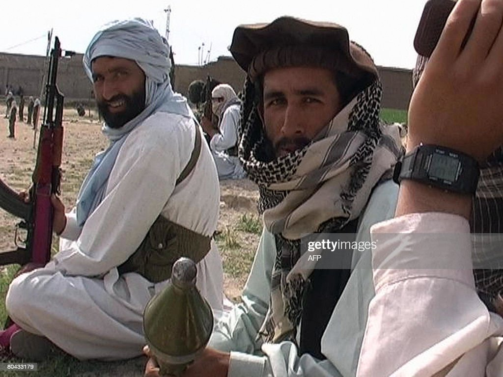 Pakistani Taliban militants gather during a public rally in Inayat Kili, a small trading rural town some 10 kms (six miles) north of Khar, the main town of Bajaur tribal district bordering Afghanistan, on March 30, 2008. Pakistan's Taliban movement 30 March welcomed an offer by the new premier to hold talks with militants but urged Islamabad to abandon the US-led 'war on terror.' AFP PHOTO/ Zafarullah KHAN
