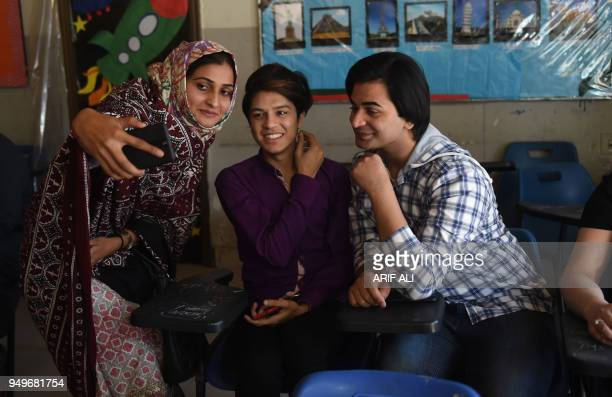 Pakistani teacher Eeman takes selfie with students on the first day of the first transgender school in Lahore on April 21 2018 The school 'The Gender...