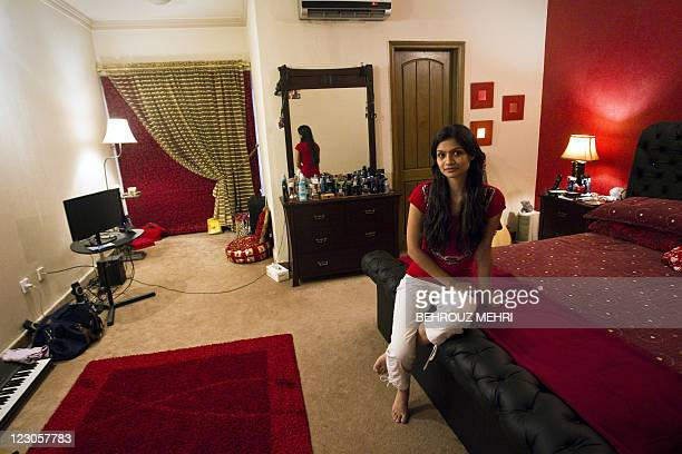 Pakistani teacher Meena Gabeena 25 yearsold poses in her bed room in Islamabad on July 31 2011 Meena is a junior school teacher holding a degree in...