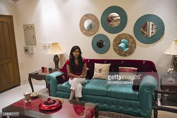 Pakistani teacher Meena Gabeena 25 yearsold poses in her sitting room in Islamabad on July 31 2011 Meena is a junior school teacher holding a degree...
