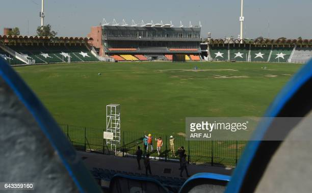 Pakistani technicians prepare to install a security camera at the Gaddafi Cricket Stadium in Lahore on February 21 2017 A top international cricket...