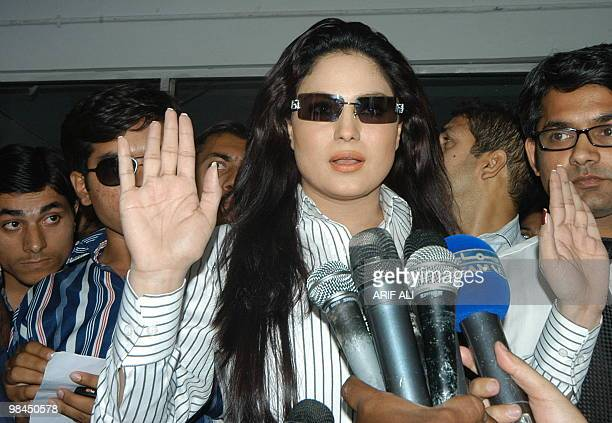 Pakistani television artist Veena Malik talks with media representatives after submitting a case against cricketer Muhammad Asif outside the police...