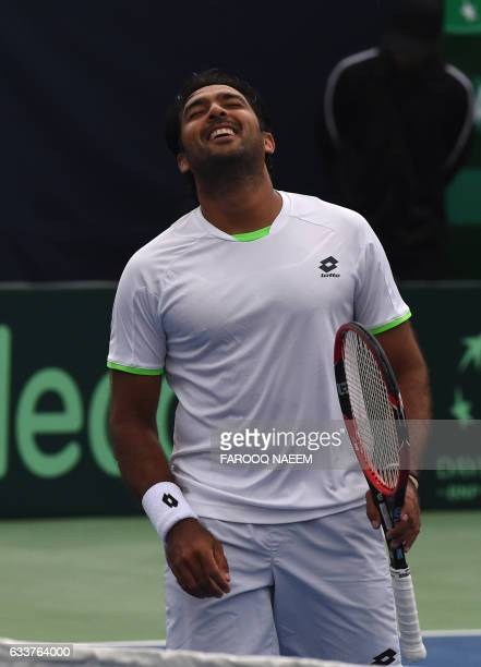 Pakistani tennis player AisamUlHaq Qureshi reacts after a point against Iranian players Shahin Khaledan and Alborz Akhavan during their men's doubles...
