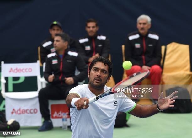 Pakistani tennis player AisamUlHaq Qureshi returns against Iranian players Shahin Khaledan and Alborz Akhavan during their men's doubles match in the...