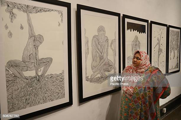 Pakistani Traditional Arts and Fine Arts Students taking keen interest in art work during an exhibition organized by National College of ArtsThe MA...