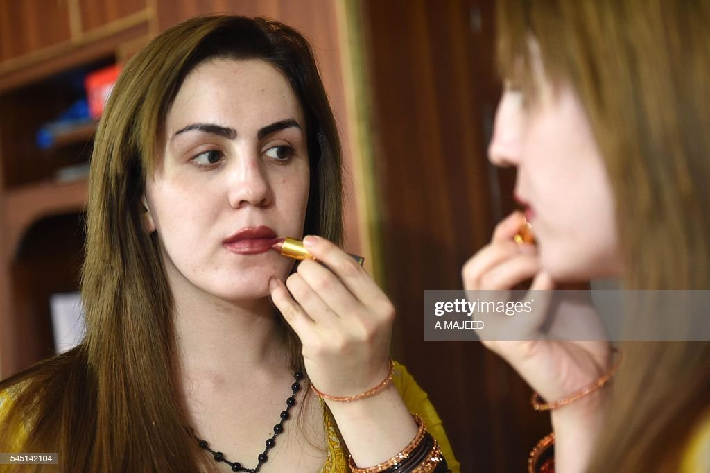 Best Pakistani Eid Al-Fitr Feast - pakistani-transgender-puts-on-makeup-ahead-of-the-eid-alfitr-festival-picture-id545142104  HD_103319 .com/photos/pakistani-transgender-puts-on-makeup-ahead-of-the-eid-alfitr-festival-picture-id545142104