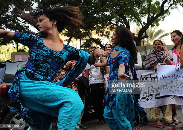 Pakistani transgenders dance during a rally in Karachi on December 7 2010 The transgender community locally called hijra hailed the order of...