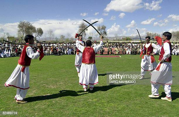 Pakistani tribesmen dance during a ceremony to celebrate country's National Day in Shakai a tribal village of the Wana district bordering Afghanistan...