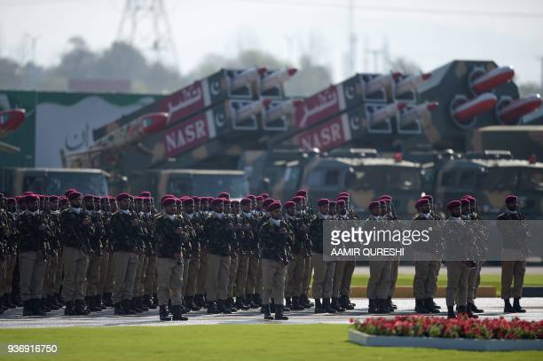 Pakistani troops from the Special Services Group stand beside missiles prior to march during the Pakistan Day military parade in Islamabad on March...
