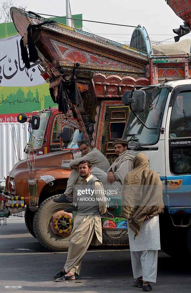 Pakistani truck drivers are pictured with their vehicles parked on a highway in protest of the February 16 Quetta bombing against Shiite Muslims, in Islamabad on February 19, 2013. Pakistani forces on Tuesday killed four men and arrested seven others accused of killing Shiite Muslims, including an alleged mastermind of a bomb attack that killed 89 people, officials said. AFP PHOTO/Farooq NAEEM