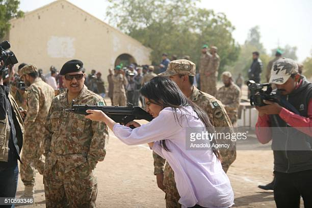 Pakistani university student aims her rifle during military training in Karachi Pakistan on February 16 2016 Large areas of Pakistan are increasing...